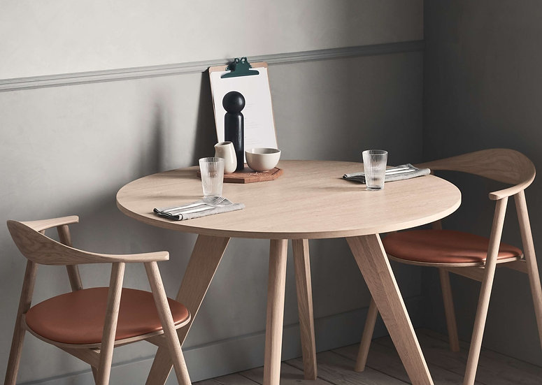 bolia new mood small dining table with swing dining chairs