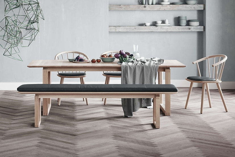 bolia nord dining table with sleek chairs and bench