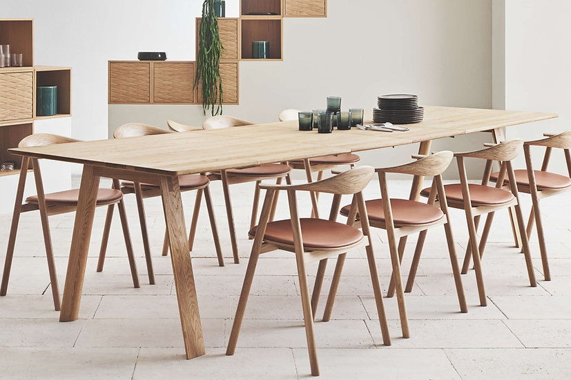 bolia hill dining table extended with swing chairs