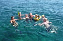 Family swimming in ocean