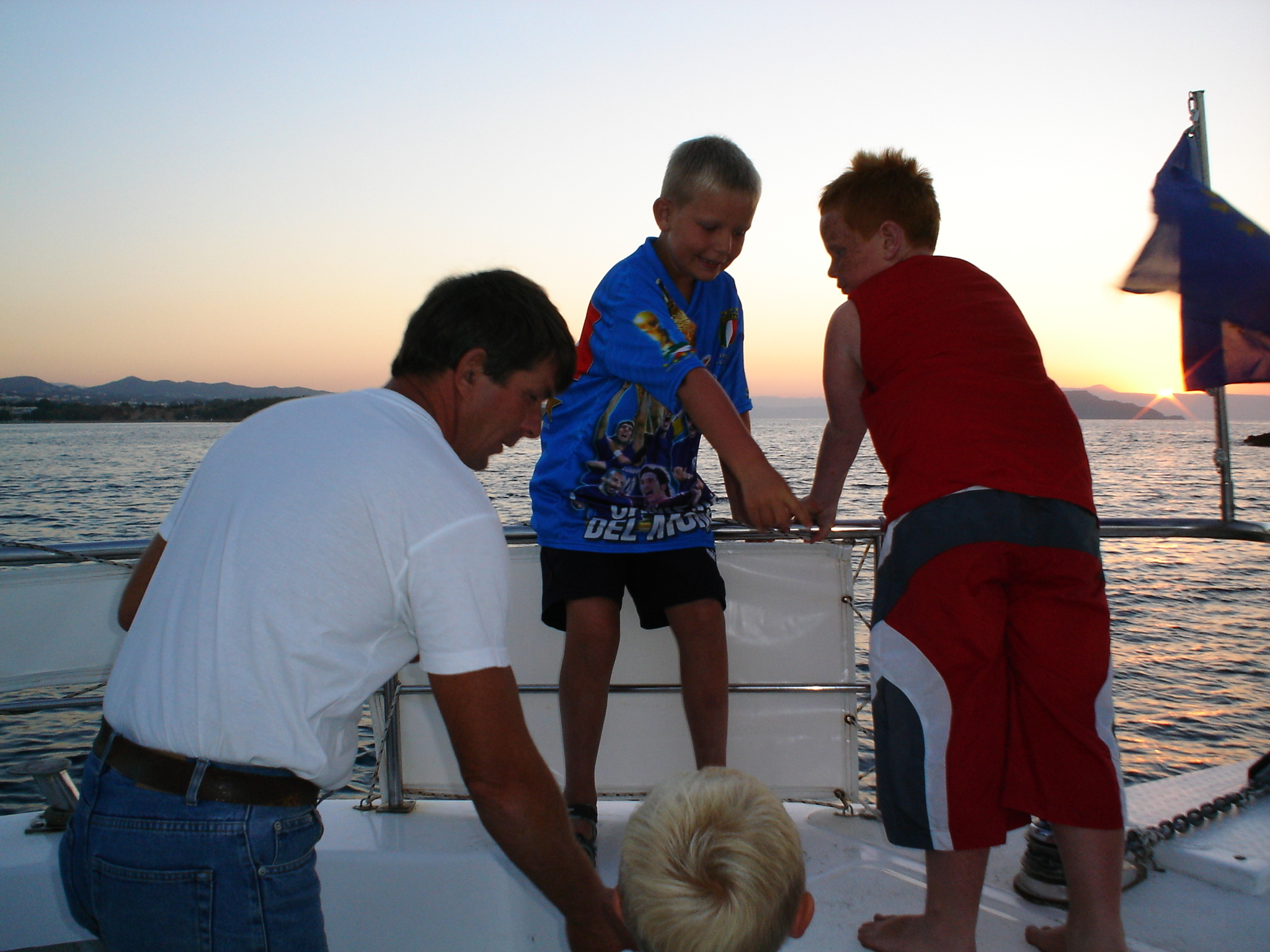 Family helping out on boat