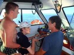 Kids talking on Captain Nick's Boat