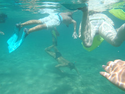 Kinds underwater snorkling together