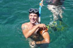 Man with sea animal
