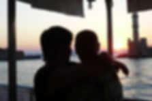 Couple watching the sunset on boat