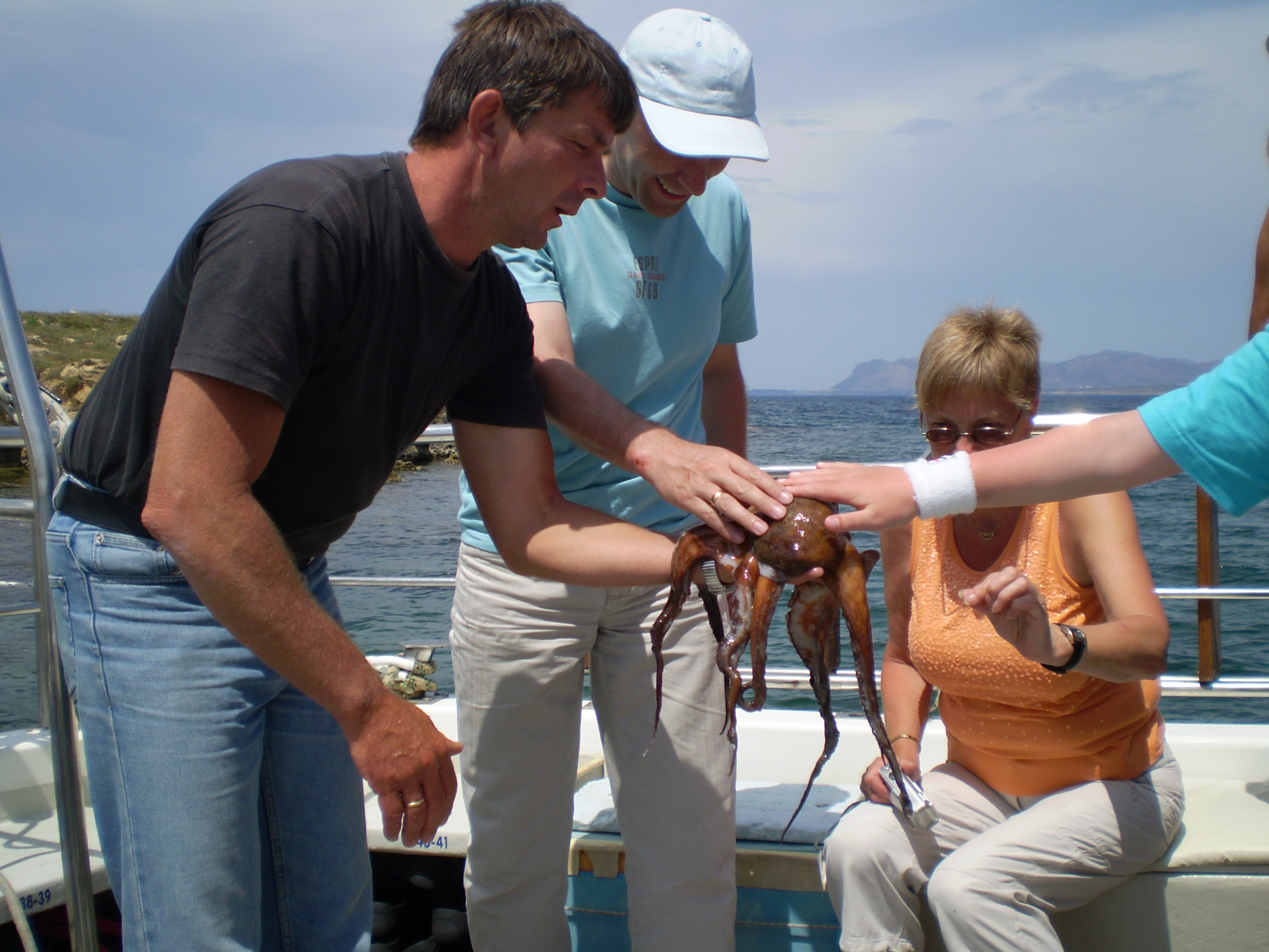 Family touching squid