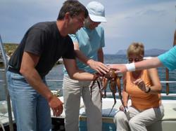 Family touching squid