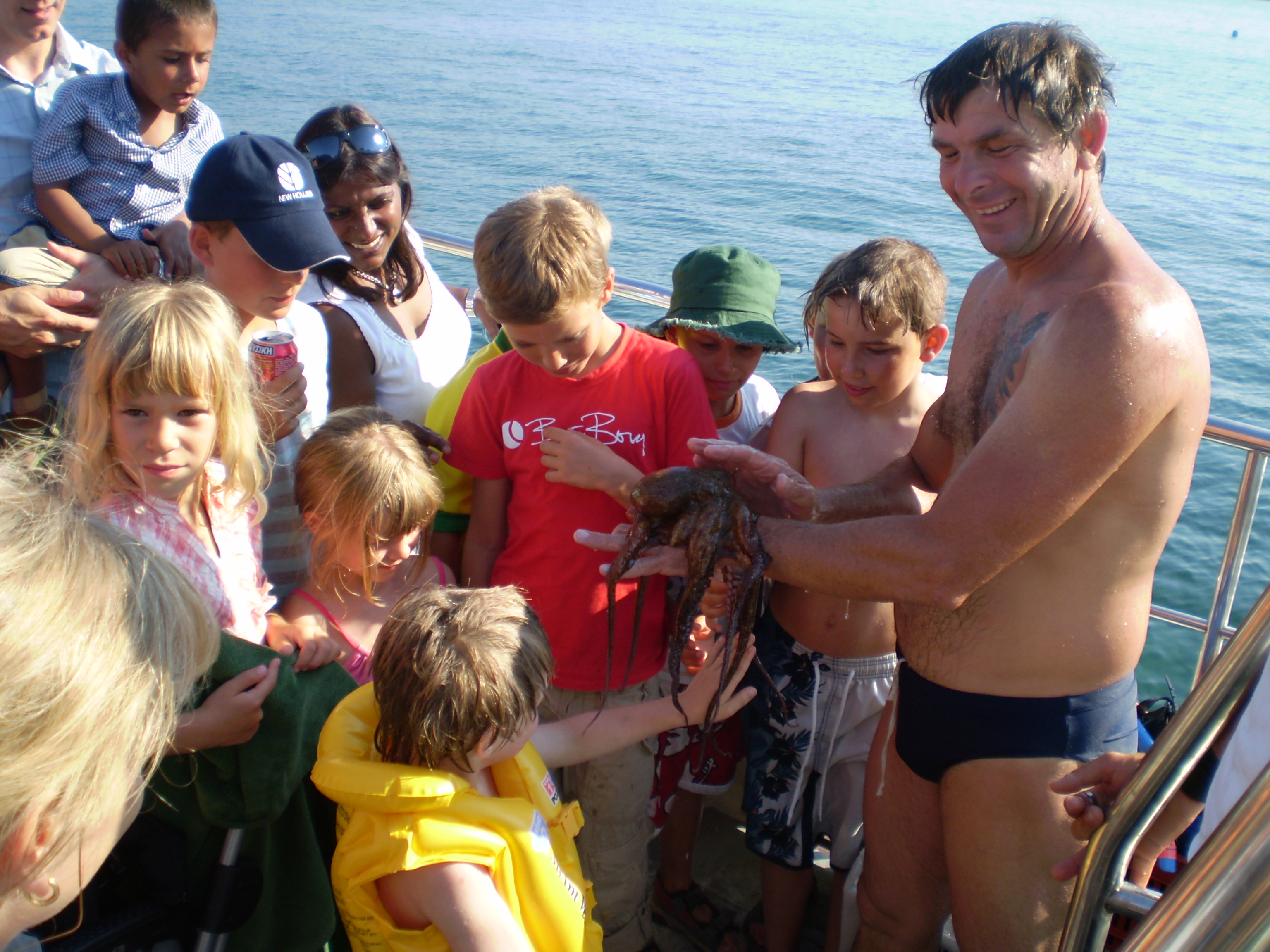 Family playing with sea animal