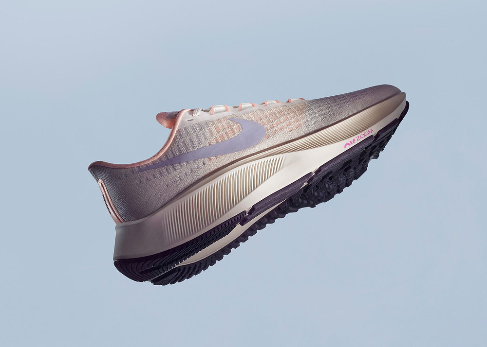 White Nike Pegasus 37 with blue background