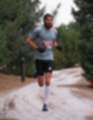 Online Running Coach Brandon Birdsong running down a snowy dirt road