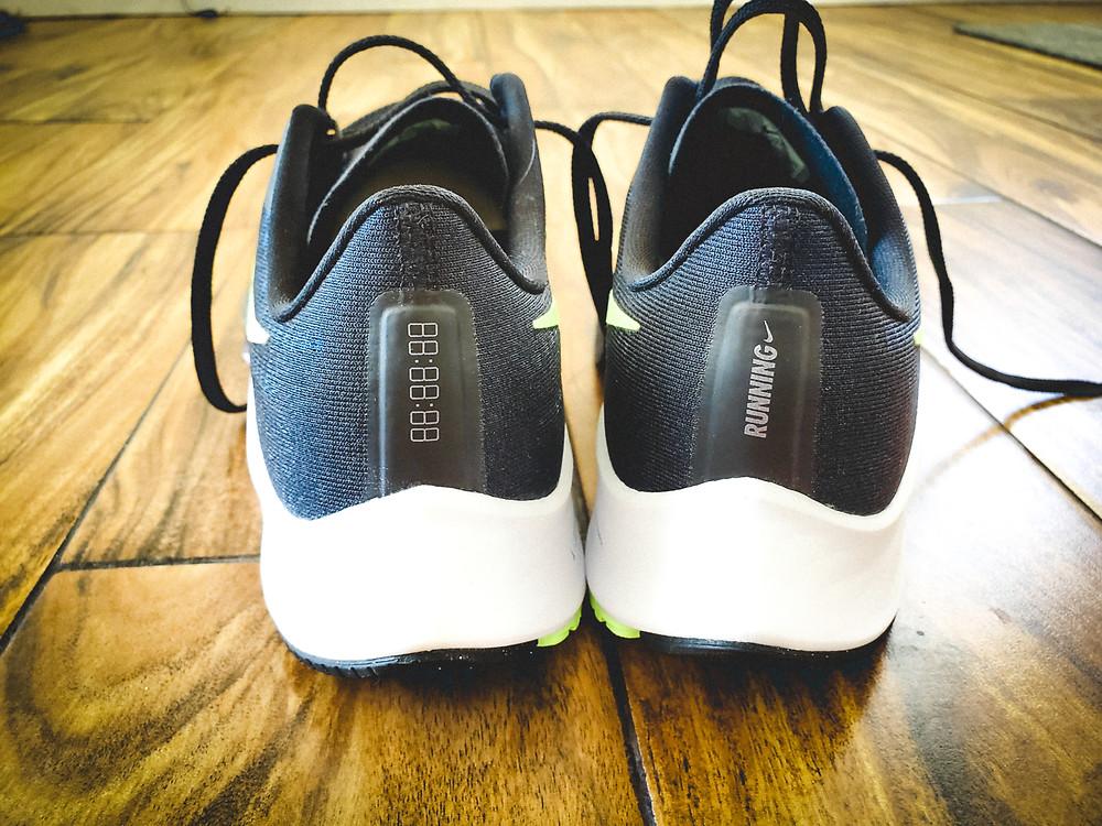 Black pair of Nike Pegasus 37 with the Nike logo