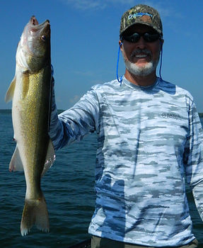 """Mark with a 23"""" walleye caught trolling a crankbait."""