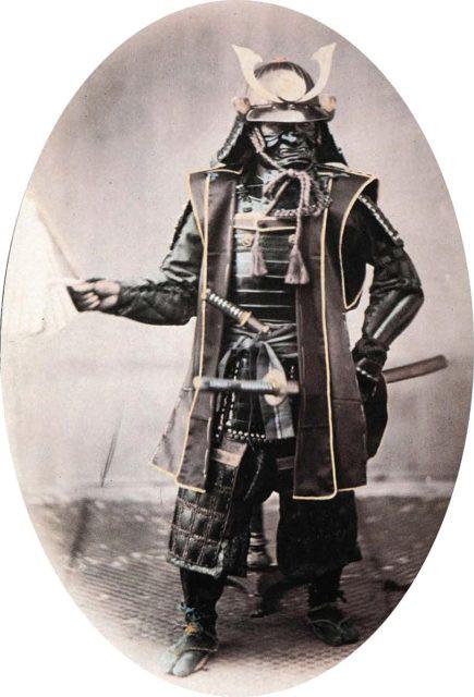 Samurai in armor, 1860s. Hand-coloured photograph by Felice Beato.