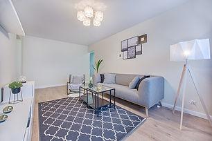 gray-fabric-sofa-placed-indoor-1571468.j
