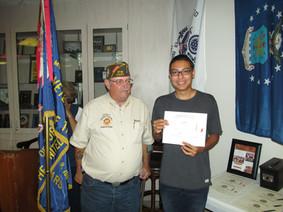 Commander Weaver Brian giving awards
