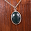 Hand set moss agate stone necklace on wood background