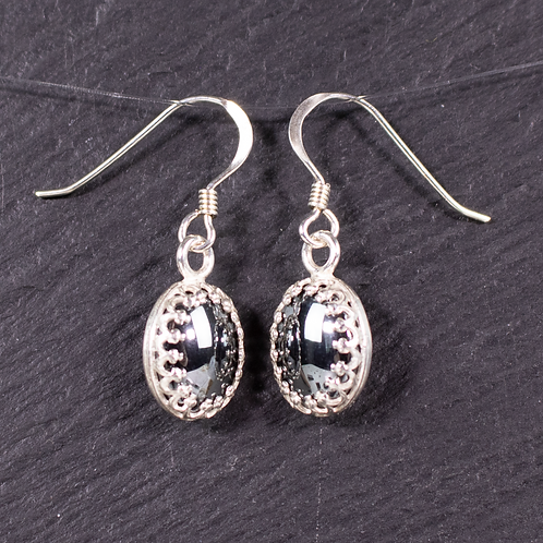 Hematite earrings on a slate background