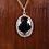 Hand set hematite stone necklace on wood background