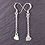 Silver long drop heart earrings on a slate background
