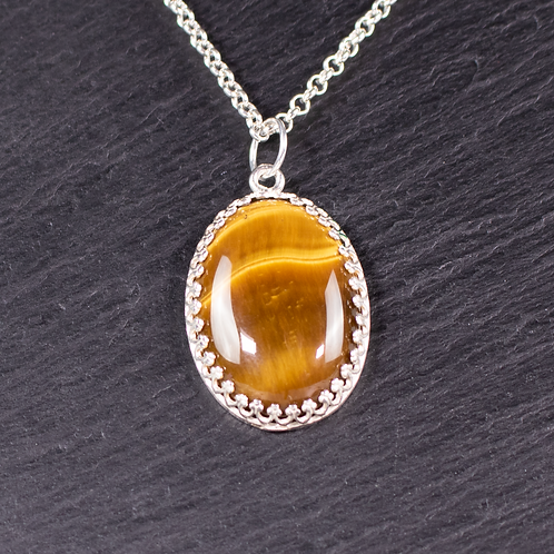 Hand set tigers eye stone necklace on slate background