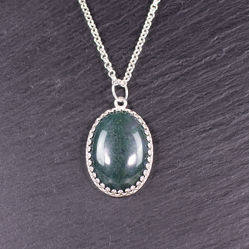Hand set moss agate stone necklace on slate background