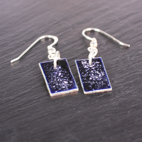 Space enamel rectangle earrings on slate background