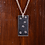 Silver star stamped necklace on wood background