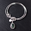 Triple loop bangle set with gemstone charm on slate background