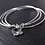 Triple loop bangle set with butterfly charm on slate background