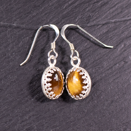 Tigers eye earrings on a slate background