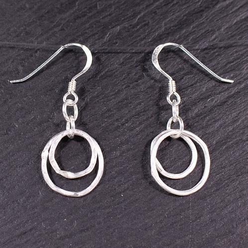 Double loop earrings on a slate background