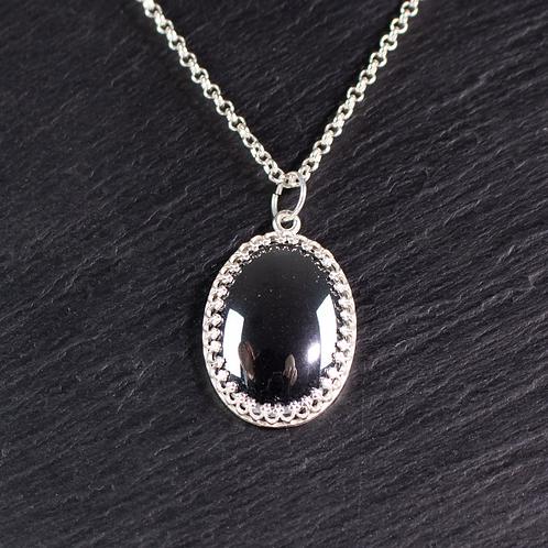 Hand set hematite stone necklace on slate background