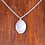 Silver hammered oval necklace on wood background