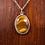 Hand set tigers eye stone necklace on wood background