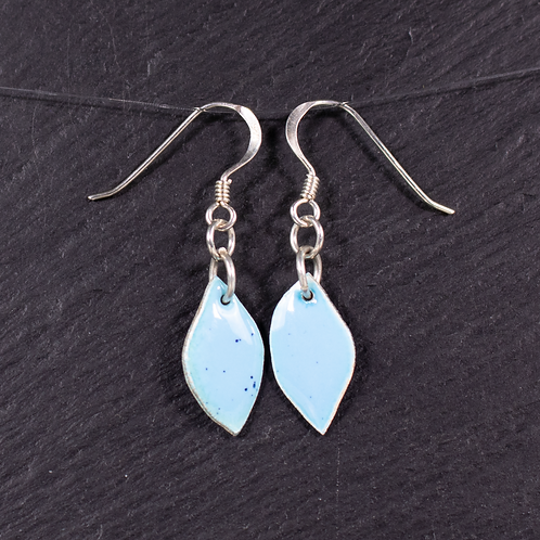 Enamelled silver earrings on a slate background