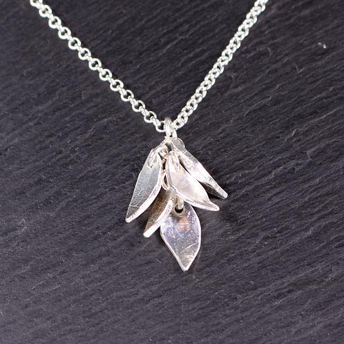 Silver leaf design necklace on a slate background