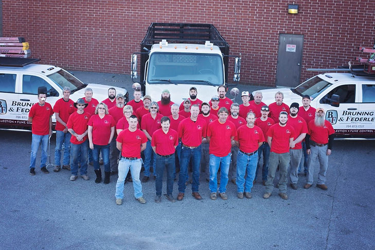 Bruning & Federle Staff group photo with service vehicles