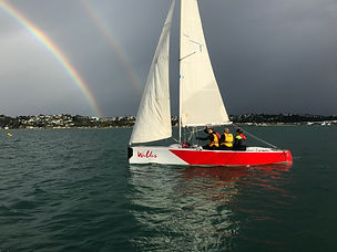 E6 Wilis Legal sailing with rainbow.jpg