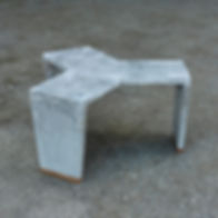 Concrete single cast table with wooden feet.