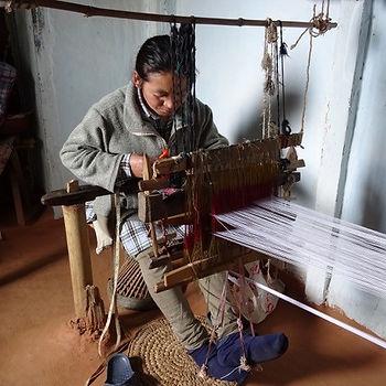 nepal woman using weaver.jpg
