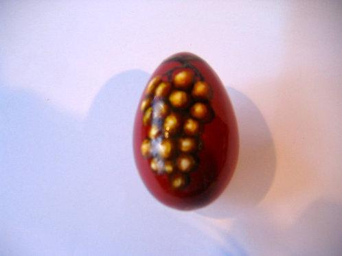 Oeuf raisin au dos un tire bouchon