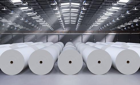 3d-rendering-white-large-paper-rolls-in-factory.jpg