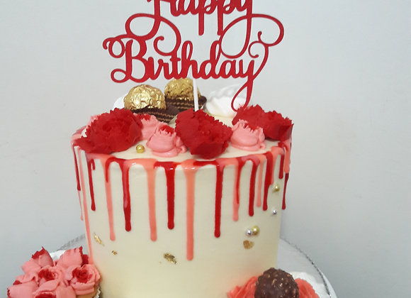 Red and pink birthday drip cake