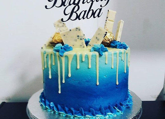 Blue buttercream drip cake with topper