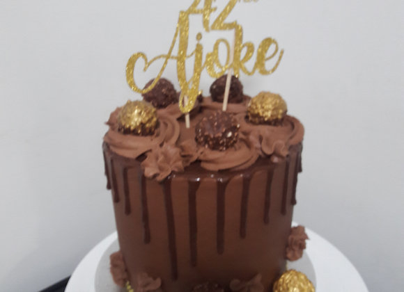 Chocolate drip cake with personalised topper