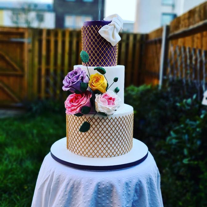 purple and lace 3 tier wedding cake.jpg