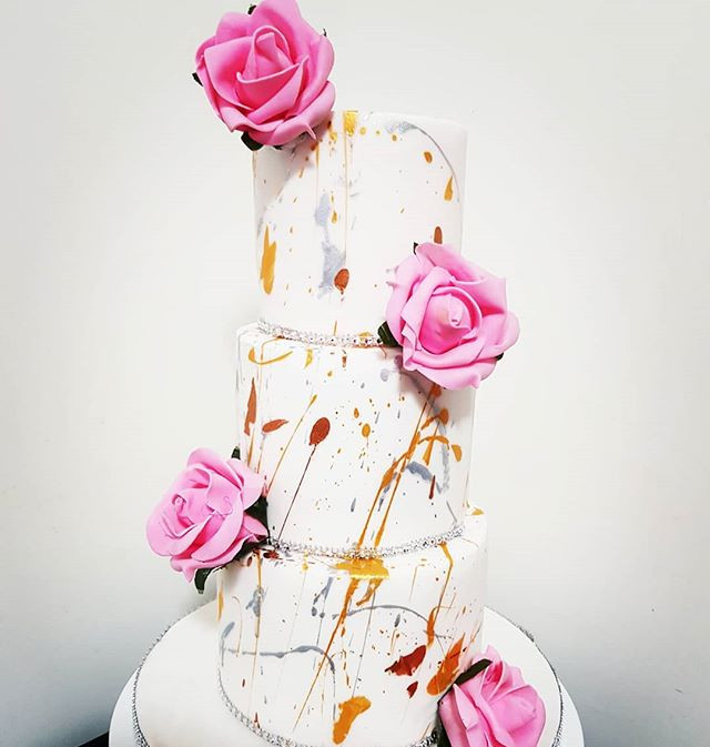 Colour splash cake with pink flowers