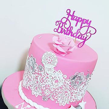 lady's pink birthday cake