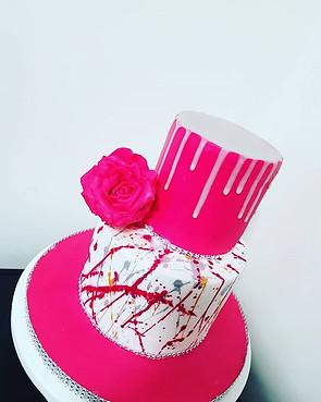 Pink and white splash cake