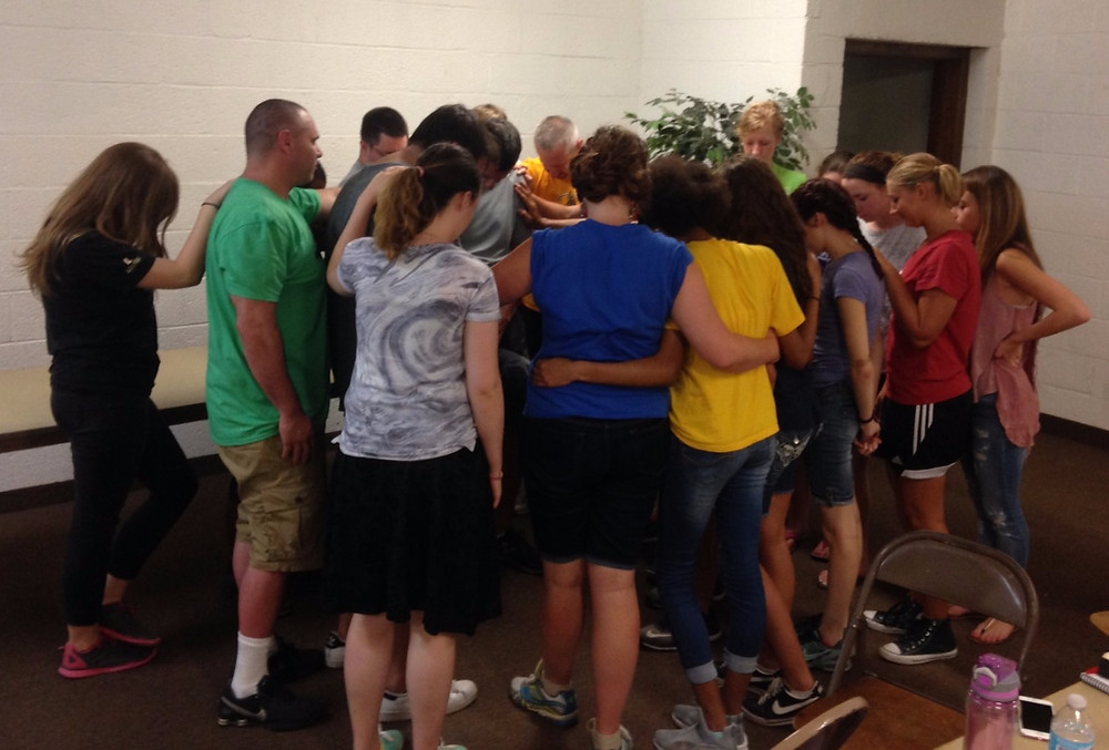 Our team lays hands on Pastor Larry and prays for Grace Baptist Church and God's work in River Rouge.